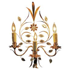 A Pair of Three Light Wall Sconces