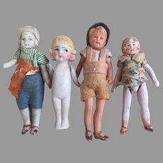 Four Little All Bisque Dolls