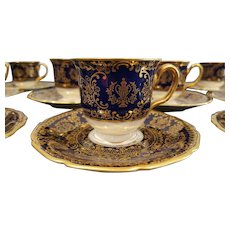 11 Footed Cobalt Blue & Gold  Rosenthal Ivory Demitasse Cup & Saucers Set with handpainted floral center