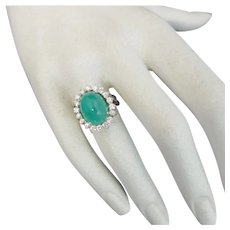 Lady's 8.75 Carat Cabochon Emerald and 1.10 carat VS Clarity and F to G color Diamond Ring