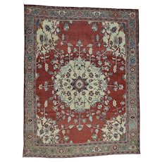 Hand-Knotted Antique Persian Serapi Open Field Oriental Rug
