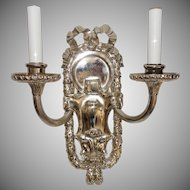 Pair of Polished Nickel E.F. Caldwell Bow-Top, Two-Arm Neoclassical Sconces
