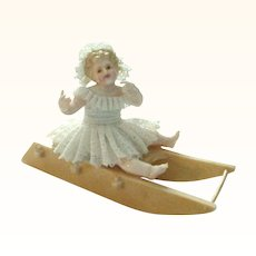 Cutest Ever Antique Miniature Baby on Sled Dresden Lace Figurine