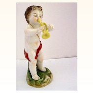 Porcelain Cabinet Figure of Putti Blowing a Horn Trumpet or Bugle