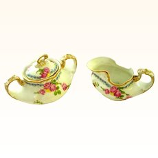 Rose Strewn Limoges Creamer and Covered Sugar