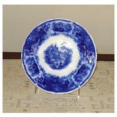 """Large Flow Blue """"Non-Pareil"""" Saucer"""