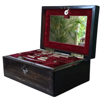 Antique English sewing box with fitted interior and mother of pearl sewing tools