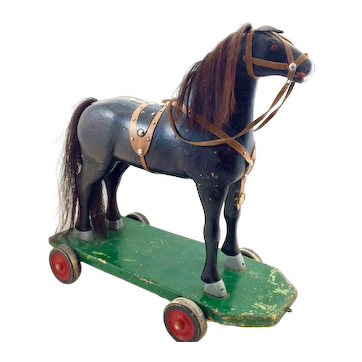 Early Child's Hand Carved Horse Pull Toy