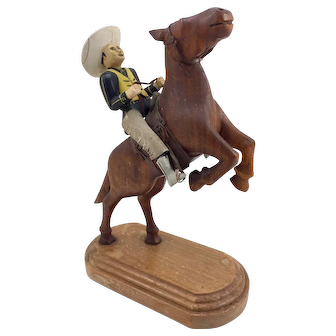Folk Art Carving of a Cowboy and Horse