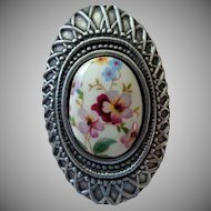 Pretty Floral Pin Silver Tone Cupid Marked Vintage