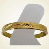 Gold Tone Chased and Textured Bangle with Safety Chain Vintage