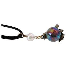 JJ Iridescent Glass Orb Brass Hand Pendant Black Cord Vintage
