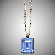 Vintage synthetic color change sapphire pendant set in 14 kt gold