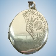 Vintage rolled gold oval locket on a chain