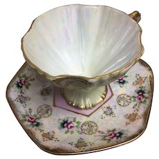 Vintage pearlescent  and gold gilded teacup and saucer