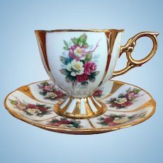 Vintage roses and gold gilt teacup and saucer