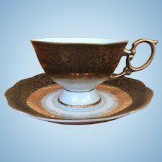 Vintage teacup and saucer in browns, gold and white