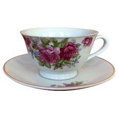 Vintage porcelain teacup and saucer with rose design