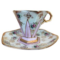 Vintage Pearlescent and gold gilt teacup and saucer