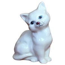 Royal Doulton white cat with blue eyes.