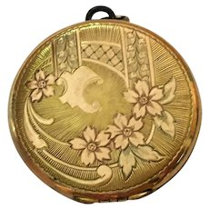 Vintage 1 3/8th diameter Round gold and rose tone locket with fabulous hand engraving