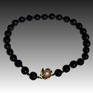 Vintage Birks Onyx bead necklace with 14 KT pearl clasp