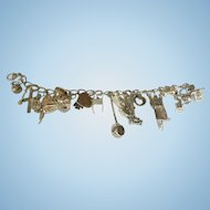 Vintage Sterling silver charm bracelet with 24 sterling silver charms