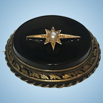 Victorian Mourning brooch with hair curl behind glass