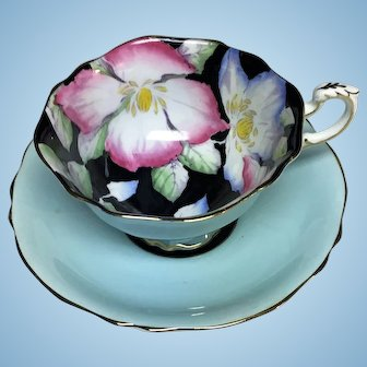 Paragon teacup set turquoise with flowers against a black background