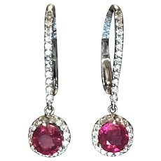 Natural Ruby and diamond earrings in 14 kt white gold
