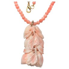 Vintage pinkish coral bead necklace with coral carving.