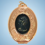 Vintage rose gold plated cameo locket