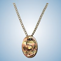Vintage rose and yellow gold poppy pendant on chain
