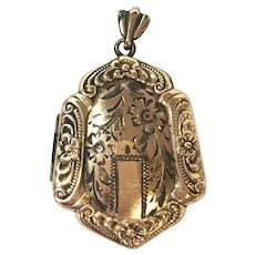 Victorian style hand engraved shield shaped locket