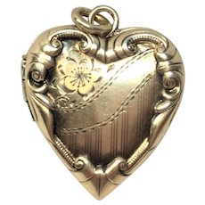 Vintage repousse and hand engraved heart locket