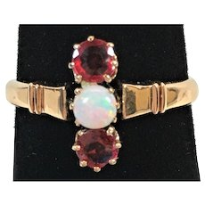 Victorian ruby and opal ring is 14 kt gold