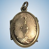 Victorian rolled gold ornately engraved locket