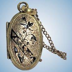 Vintage Victorian style rolled gold and black enamel locket