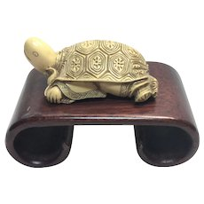 Vintage post WWII turtle old man Netsuke with faux rosewood stand