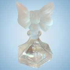 Vintage clear and frosted glass perfume bottle with bow tie top