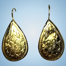 Vintage 14 kt hand worked repousse earrings with a flower design