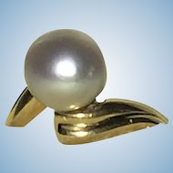 Vintage 7 mm silver Akoya pearl on a 10 kt ring