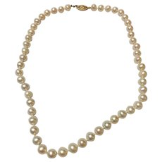 Vintage 18 inch cultured pearl necklace with 14 kt gold clasp