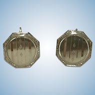A finely engraved octagonal cufflink converted to earrings