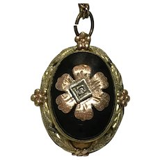 Vintage tri colored gold and onyx locket with a single cut diamond