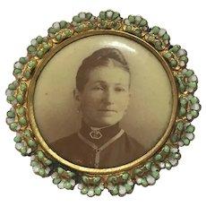 Vintage enameled round photo pin of a matron