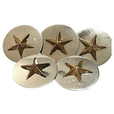 Five vintage steel and brass star buttons