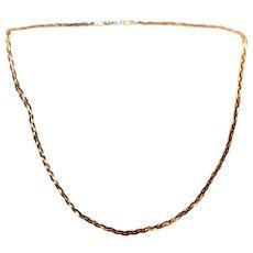 Vintage braided serpentine necklace in 14 karat yellow gold