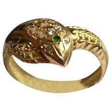 Vintage 18 karat gold, diamond, and emerald snake ring