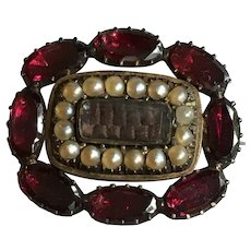 Victorian 9 karat hair mourning brooch with seed pearls and rhodolite garnets